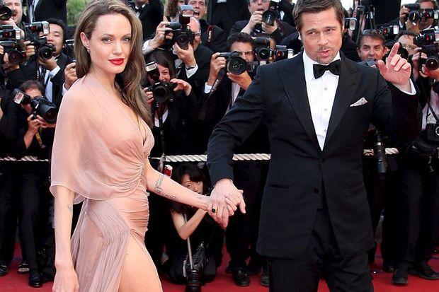 Angelina geziyor Brad ev işlerini yapıyor!